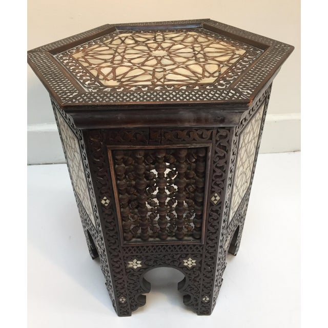 Antique 19th century Syrian mother-of-pearl inlaid side table. Hexagonal hardwood side table with mother-of-pearl inlay...
