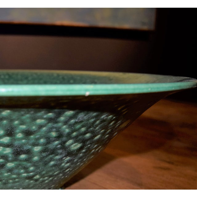 A vibrant Chinese green ceramic decorative bowl with an amazing crackle glaze. For decorative purposes only. A close up...