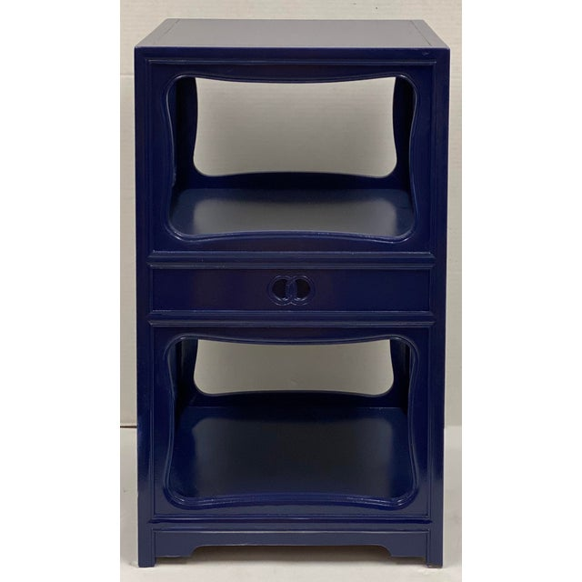This is a pair of Michael Taylor for Baker Furniture side tables in a new navy lacquer finish. They are marked and in very...
