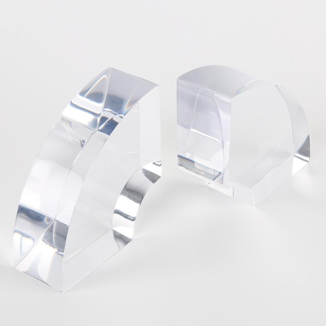 A pair of thick and chunky acrylic bookends in quarter-circle form. See this item in our Brooklyn showroom, 61 Greenpoint...