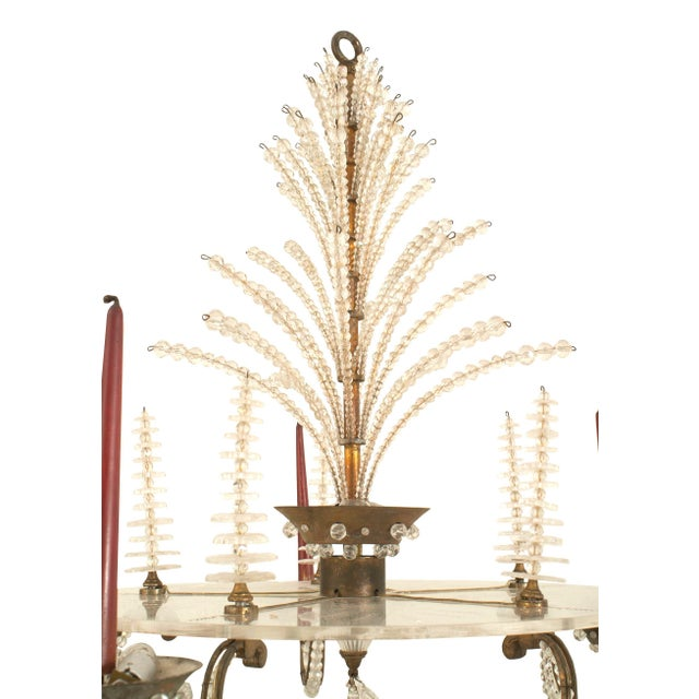 French 1940s oxidize bronze chandelier with five scroll arms trimmed with glass beads emanating from a Lucite ribbon and...