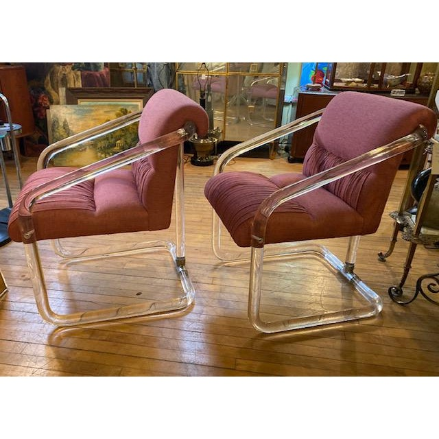 This is a chic and desirable pair of Rare signed late 1970s/early 1980s Lion in Frost curved lucite accent chairs in the...