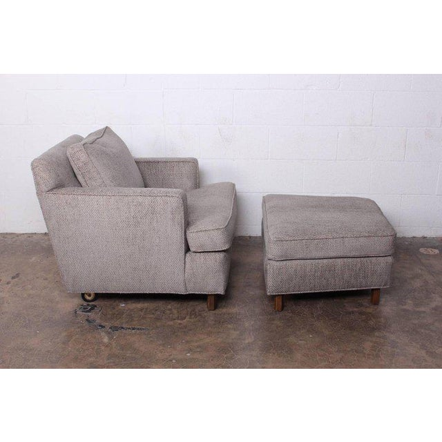 A lounge chair and ottoman designed by Edward Wormley for Dunbar. Measures: chair 30 W x 35 D x 27.5 H ottoman 28.5 W x 23...