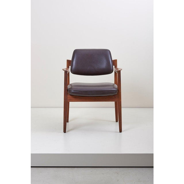 Really elegant Jens Risom Armchair in solid wanlut and high quality aniline dark brown leather by sorensen.
