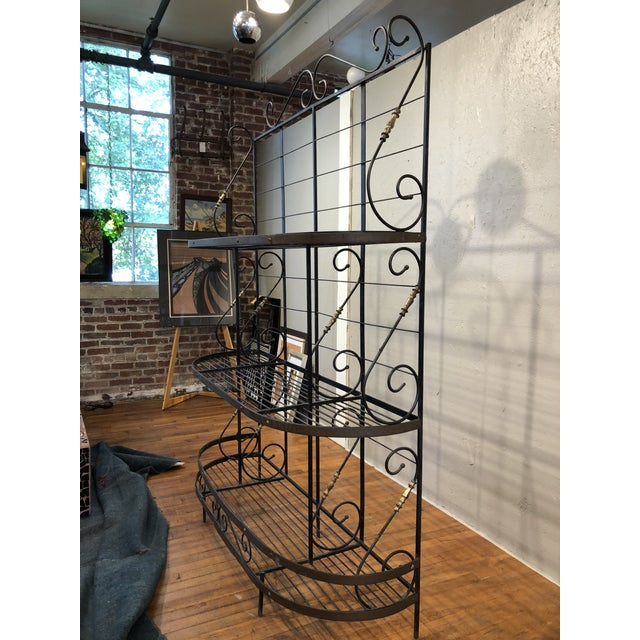 Complete your porch or sunroom with this large vintage three tier baker's rack with black and brass scrolling metalwork...