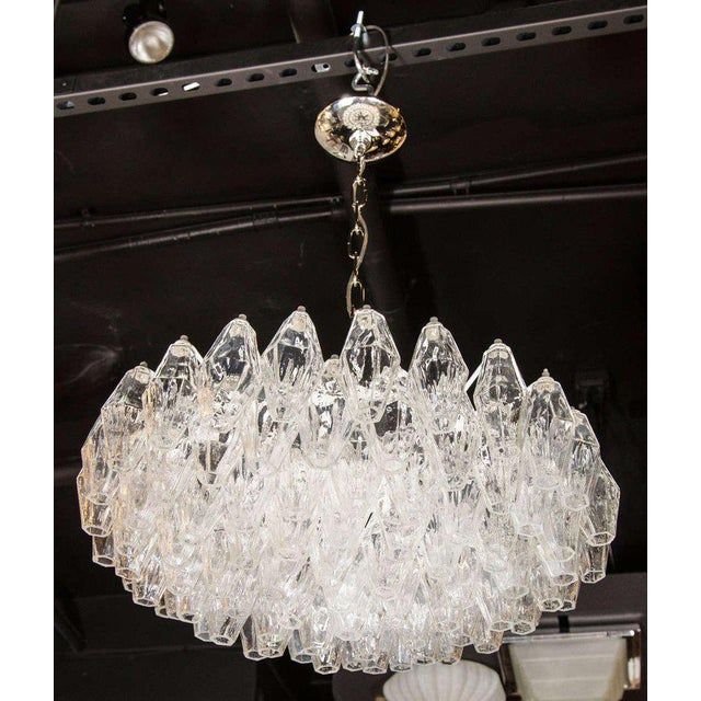 This luminous modernist glass chandelier features numerous handblown Murano translucent glass polyhedral shades. Each...