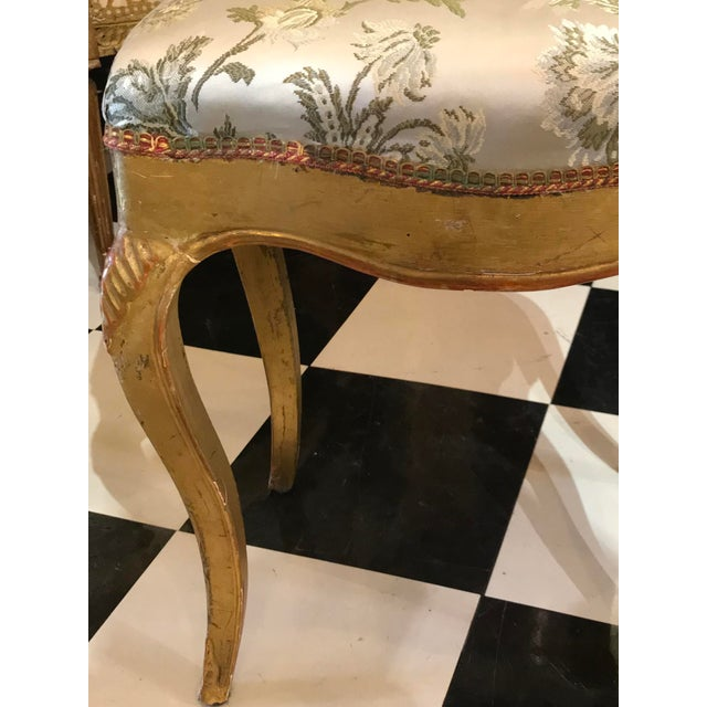 Gilded Stool with silk fabric.