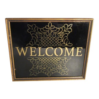 Reverse Painted Gold Welcome Sign on Black Glass in Gold Frame For Sale