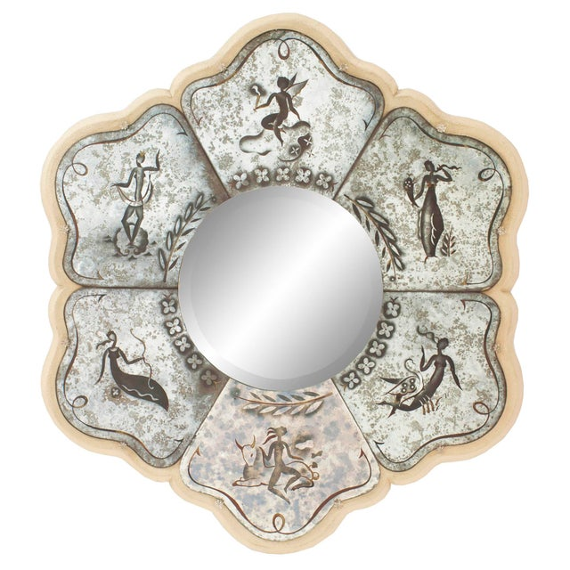 French Mid-Century round mirror with a scalloped off white frame having verre eglomise decorated panels with zodiac...