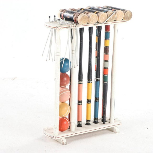 """The set includes a stand, six mallets, five balls, two stakes, and eight wickets. - Dimensions 19.75"""" W x 25.75"""" H x 7.75""""..."""