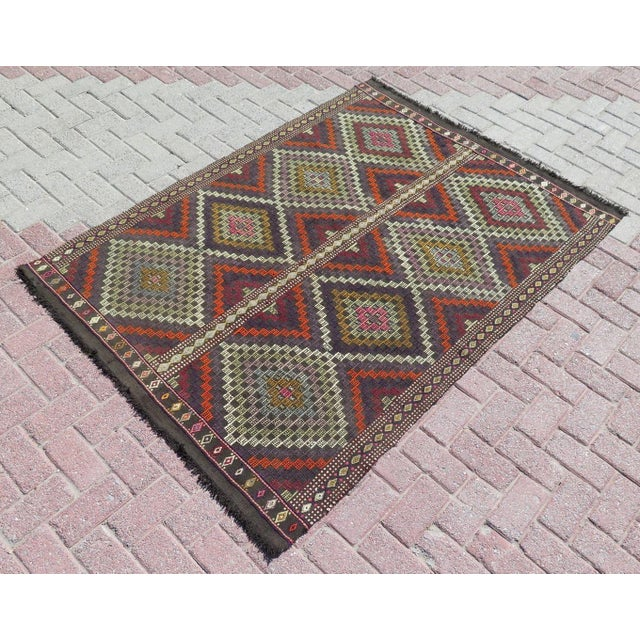 Vintage anatolian Turkish handwoven rug. Naturally dyed, beautiful colors with the traditional nomad diamond pattern....