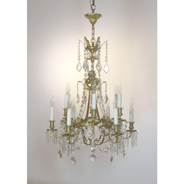 Gilt bronze finish with the original patina. Originally candle. Delicate and detailed cast bronze frame. Height is...