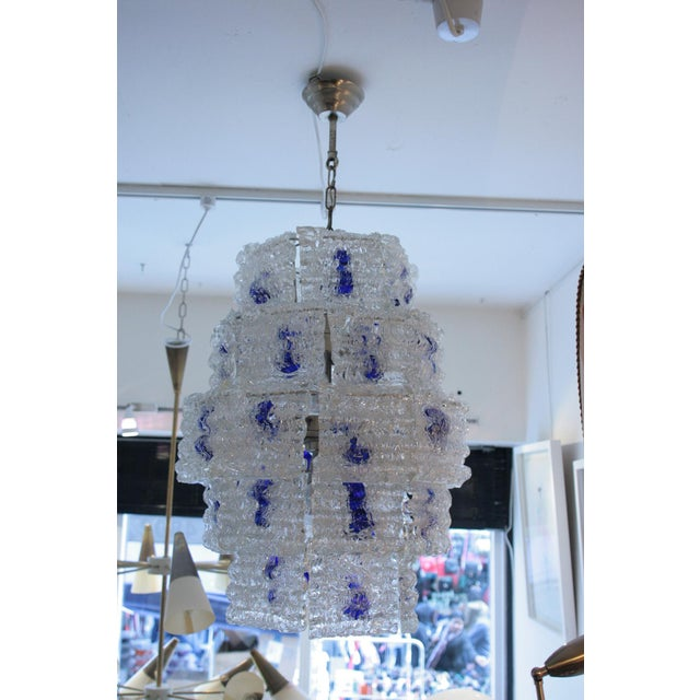 A 1960s Italian design light, blown clear frosted glass components with blue blown glass in the middle on a steel...