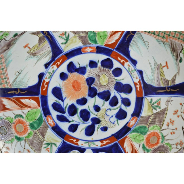 Offered is a large size (17.625) 19th century Japanese Imari charger featuring two alternating designs, for a total of six...
