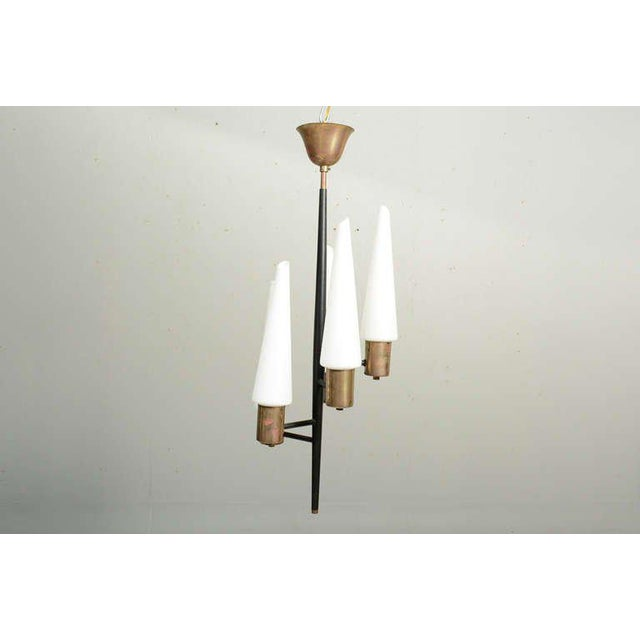 For your consideration a vintage swiss chandelier. Aluminum body painted in flat black with brass hardware and five...