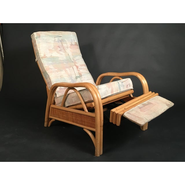This awesome Mid-Century rattan/bamboo recliner has a flip out foot rest. Extremely comfortable! Upholstery is an abstract...