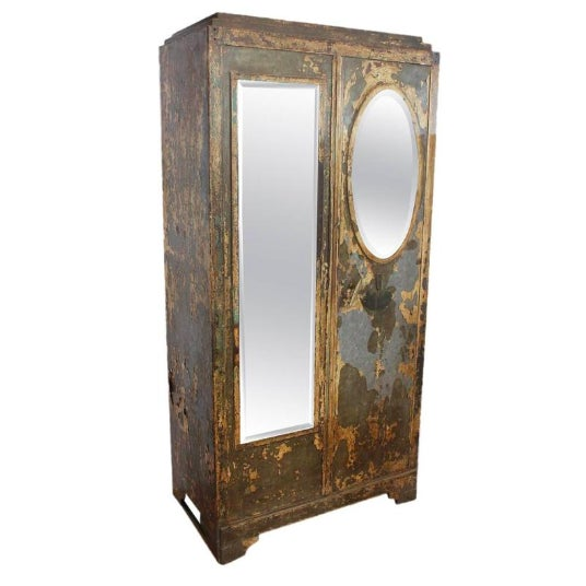 Antique French metal cabinet with beveled mirrors.