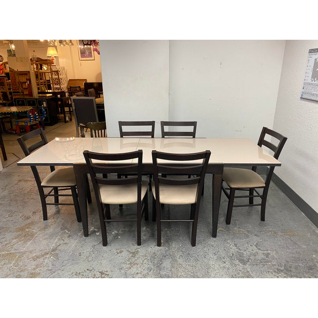 Design Plus Gallery presents a Calligaris Extendable Dining Table Set. Set comes with six side chairs. Upholstered in a...