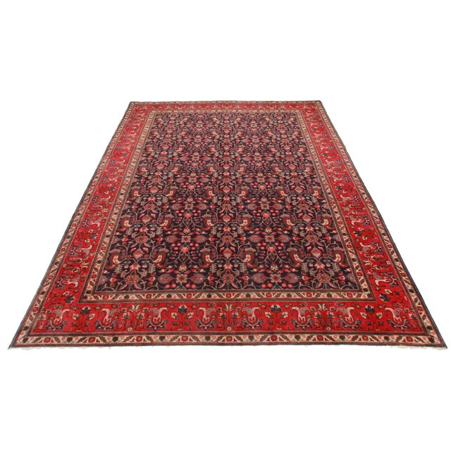 Hand knotted wool Persian Tabriz rug with beautiful floral design.