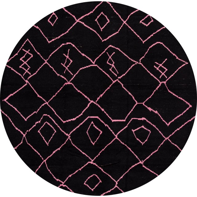 Beautiful Moroccan-style rug, hand-knotted wool with a black field, pink accents in a gorgeous all-over tribal design....