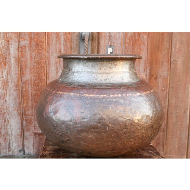 An auspicious holy water pot originally uses for water that was to be used in ceremonial events, its small and wears two...