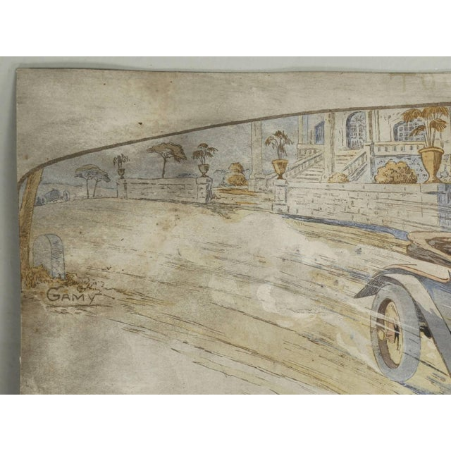 A hand-colored, lithograph signed by the French artist Gamy, depicting a Majola at speed, circa 1913. Gamy was the wire of...