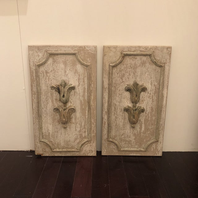 Pair of wood panels with antique fragments. So much character! Panels are distressed great to mix with modern pieces.
