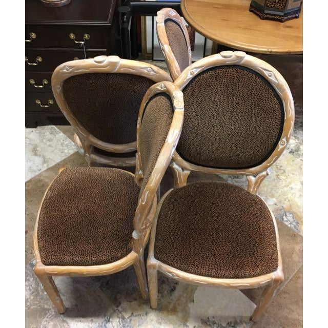Set of 4 hand carved, faux bois, chairs. These Louis XV type, oval back side chairs are stylized to resemble natural wood...