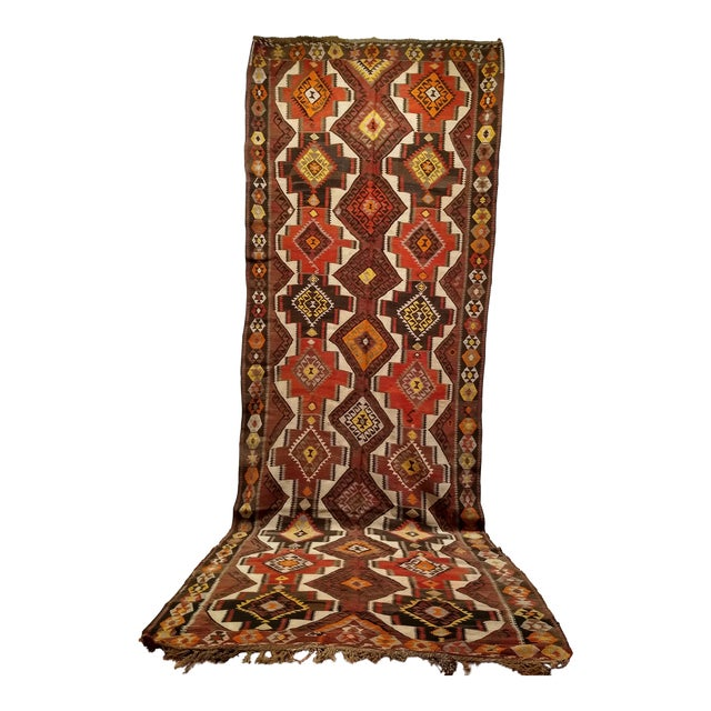 This is a kurdish Kilim from eastern turkey. The piece is very unique in its use of the white field, which makes the...