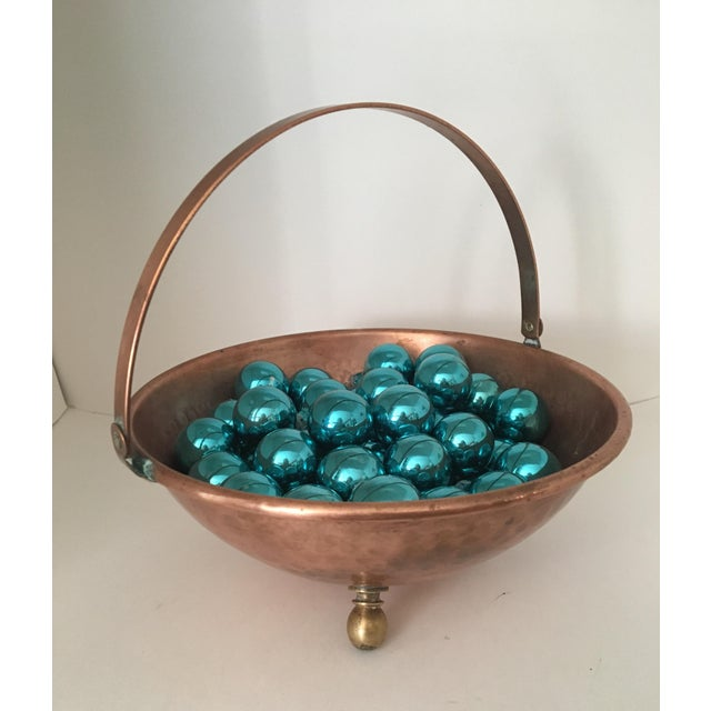 For sale is an arts and crafts hammered decorative bowl with a hinged handle and three round brass feet. It is expertly...