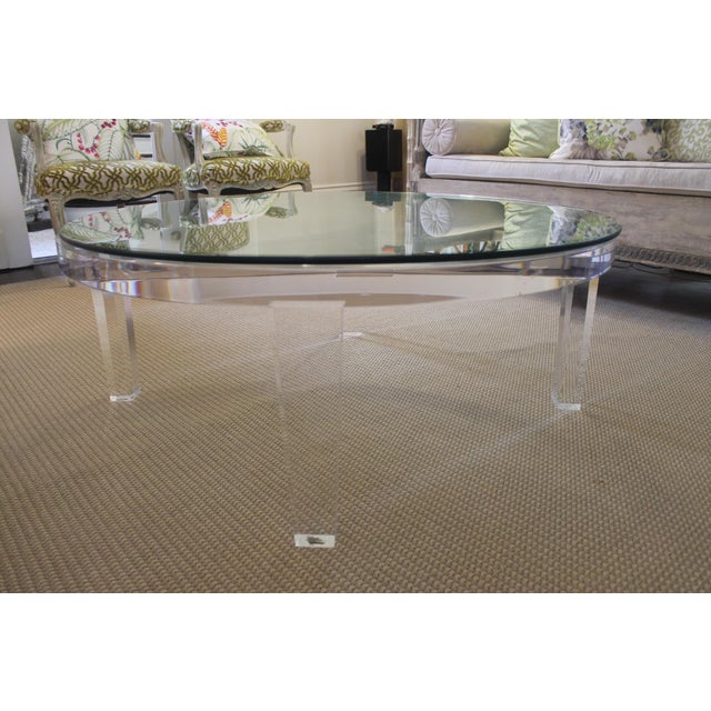 H studio's well known apex table. The heaviest Lucite possible including a 50 pound beveled glass top in mint condition....