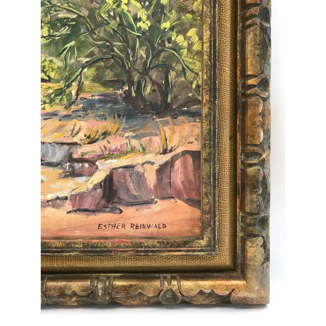 Very nice depiction of a desert landscape showing lush vegetation. Executed in oil on board. Signed 'ESTHER REINWALD' with...