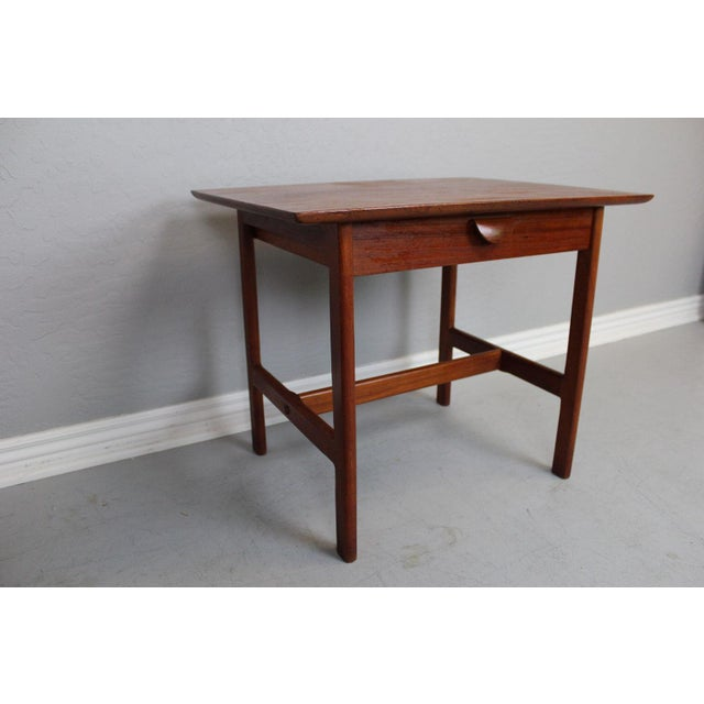Single drawer, wooden pull teak side table by George Tanier manufactured by P. Jeppeson. Circa 1960's.