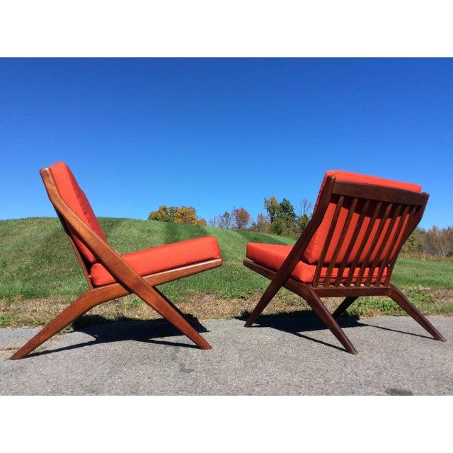 Fantastic pair of Folke Ohlsson for Dux teak scissor chairs. Just upholstered in Maharam Messenger in Poppy (024),...