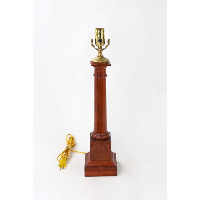This obelisk-like lamp is a wooden column, stained in a cherry color. You can get a pair lamp as there are six of these...
