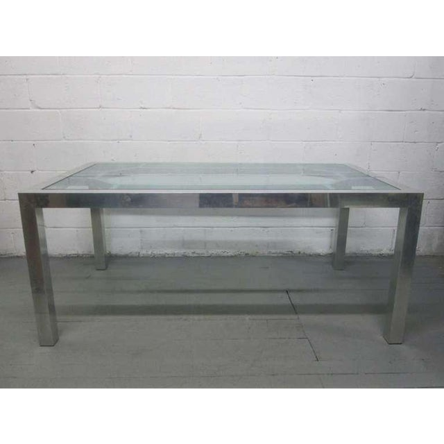 Decorative aluminium table or desk with glass top.