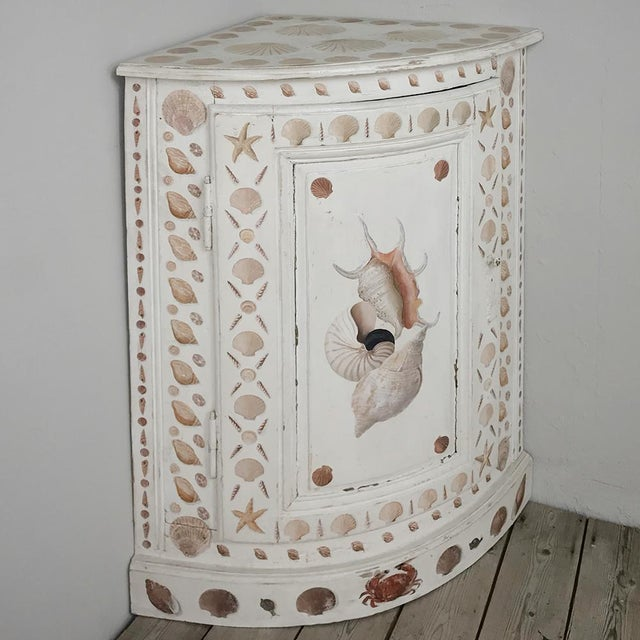 19th Century Swedish Painted Corner Cabinet features a delightful patina on the background, plus artistically excellent...