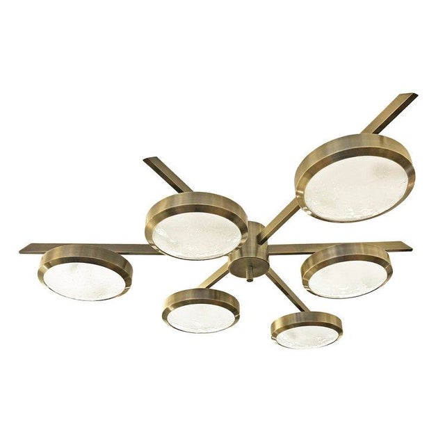 """Version two of our iconic """"Geometria Sospesa Sei"""" ceiling light features six textured glass shades on a star shaped frame...."""