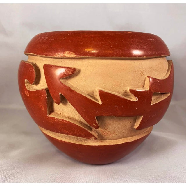 Carved redware bowl, signed Mida Tafoya (Santa Clara Pueblo, b. 1931) Acquired from the Collection of Bill Heuter and Jill...