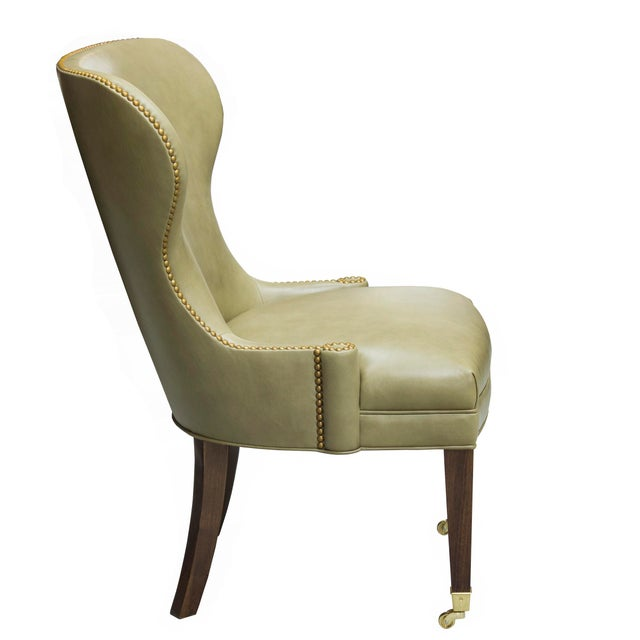 Our Sutton Place Chair is inspired by the work of Lorin Jackson, Circa 1950's This is a Showroom Sample, Upholstered in a...