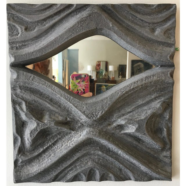 This is a fantastic mirror that is more of a wall sculpture made of pewter. It has a great brutalist design.