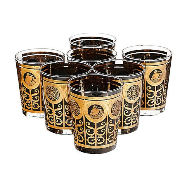 Set of seven oversized gilt and black glass old fashioned tumblers, circa 1960s.