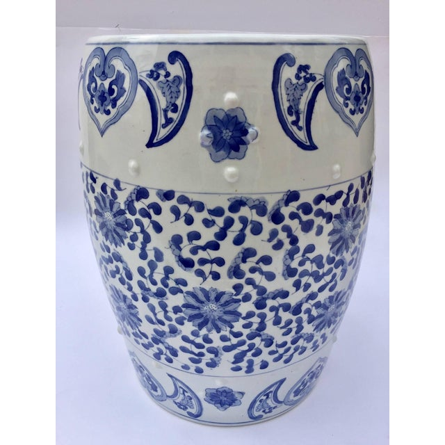 Chinese porcelain garden seats or end tables in blue and white floral motif. Blue and white Chinese ceramic garden stool...