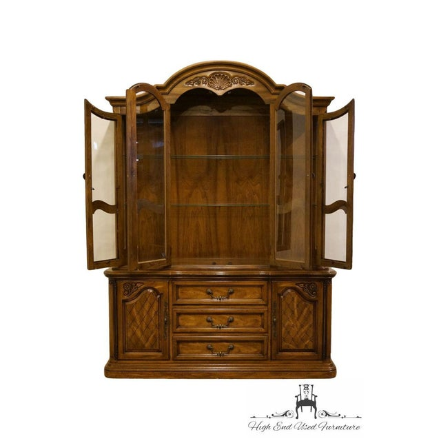 American drew French Country illuminated china cabinet. We specialize in high end used furniture that we consider to be at...