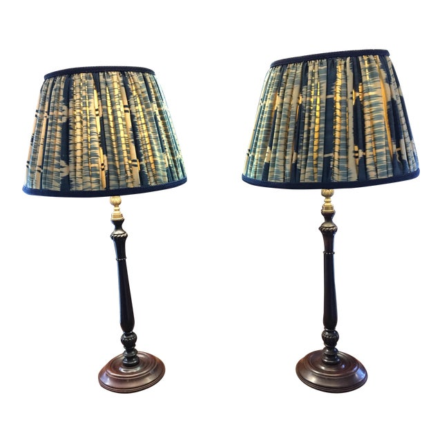 A pair of wood and brass lamps with custom hand-pleated shades. Mary Jane McCarty Collection