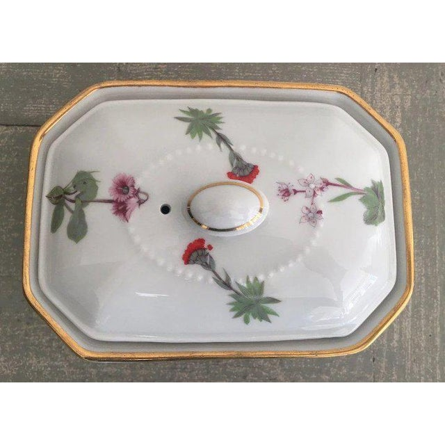 Charming Louis Lourioux Le Faune fireproof porcelain rectangular box and lid in the Wildflower pattern with gold trim....