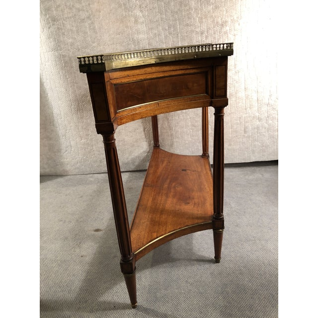 Louis XVI console table, France, circa 1800, walnut and bird's-eye maple veneer, ebonized details. In very good condition.