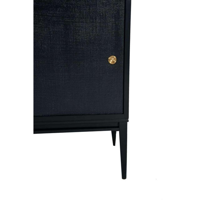 Bishop lacquered console on solid maple tapered leg frame with natural linen doors which have been colored and polished...