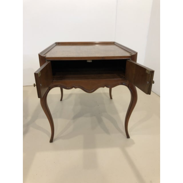 A pair of Baker Furniture side tables with storage. Mahogany frame with a gorgeous burlwood top. Minor scuffs on the legs...