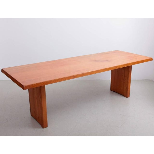 This is a rare larger version of a Classic Pierre Chapo dining table design. Made in solid elm and Charlotte Perriand like...